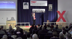 Kathleen Macferran on stage at TEDx - Monroe State Prison