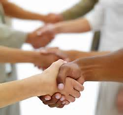 Photo of shaking hands with multiple people